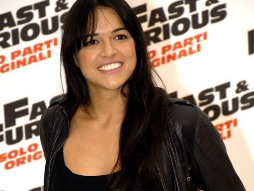 Michelle Rodriguez wallpaper possibly containing a portrait titled Michelle Rodriguez Wallpaper