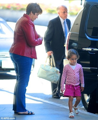 Jennifer Lopez's mother dotes over her granddaughter as they jet out of Los Angeles