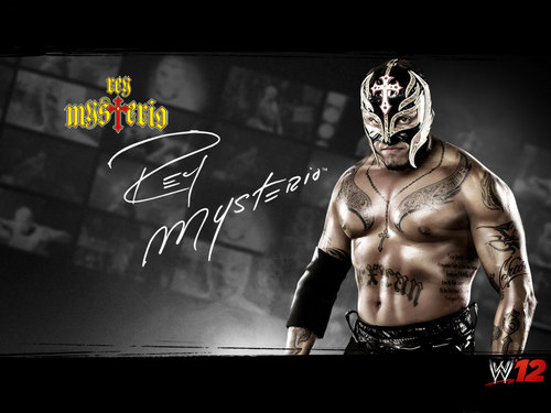 WWE wallpaper possibly containing a sign called Rey Mysterio