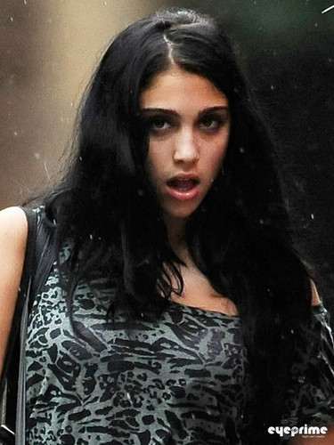 Lourdes Ciccone Leon wallpaper probably with a portrait titled Lourdes Maria Ciccone Leon Out and About in The Rain in NY, Sep 23