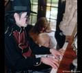 Teaching son how to play piano ) - michael-jackson photo