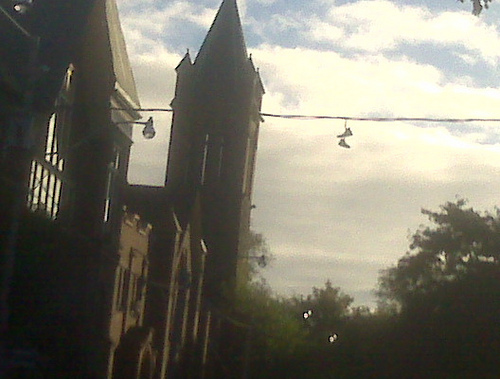 Chucks hanging from telephone wires