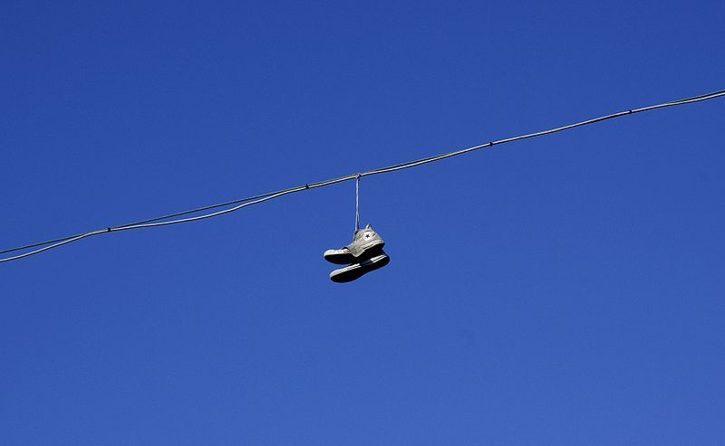 Chucks hanging from telephone wires Converse Photo