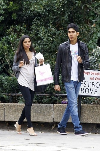 Dev and Freida achtergrond possibly with a business suit, a street, and a rijbaan, rijbanen titled Freida pinto and Dev Patel Spotted at Notting Hill- October 13, 2011