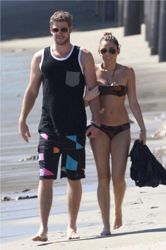 Miley Cyrus wallpaper probably with a bikini called Miley Cyrus ~ 13. October- At a Beach in Malibu with Liam