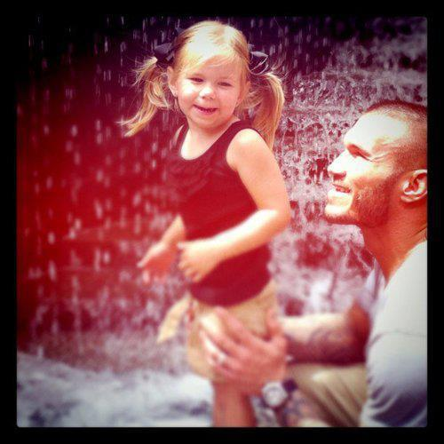Randy Orton wallpaper probably with a portrait entitled Randy and his daughter
