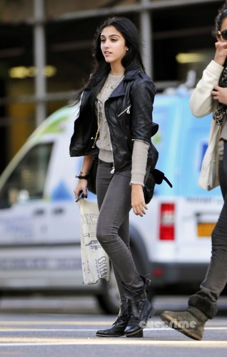 Lourdes Ciccone Leon wallpaper containing a business suit, a street, and a hip boot called Lourdes Leon seen out shopping in New York, Oct 17