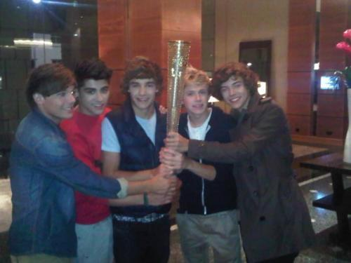 1D holding the Olympic Torch!