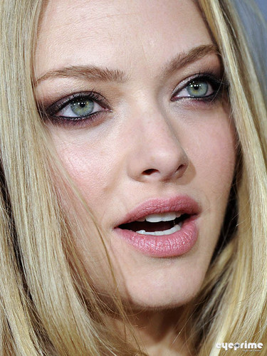 Amanda Seyfried wallpaper containing a portrait entitled Amanda, Justin and Olivia: 'In Time' Premiere in L.A, Oct 20