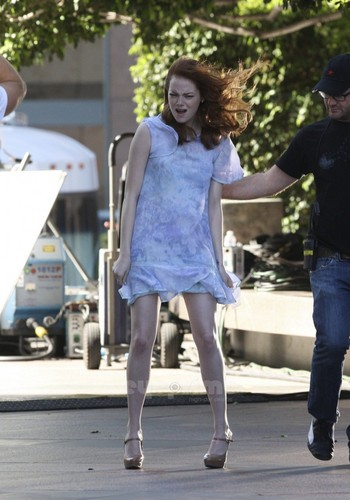 एमा स्टोन वॉलपेपर with a hip boot titled Emma Stone films a Revlon Commercial in L.A, Oct 22