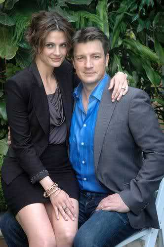 Nathan Fillion & Stana Katic karatasi la kupamba ukuta containing a business suit, a suit, and a three piece suit titled Stana & Nathan