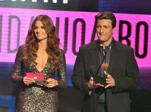 Nathan Fillion & Stana Katic fond d'écran containing a business suit and a well dressed person titled Stana & Nathan