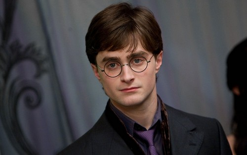 Harry James Potter wallpaper containing a business suit, a suit, and a well dressed person entitled Harry Potter wallpaper