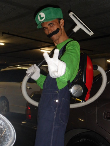 Luigi wallpaper with a vacuum and a hoover called Boo Buster Luigi