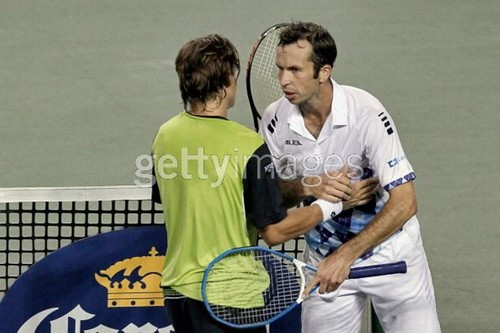 David Ferrer (L) of Spain shakes hands with Radek Stepanek (R)of the Czech Republic