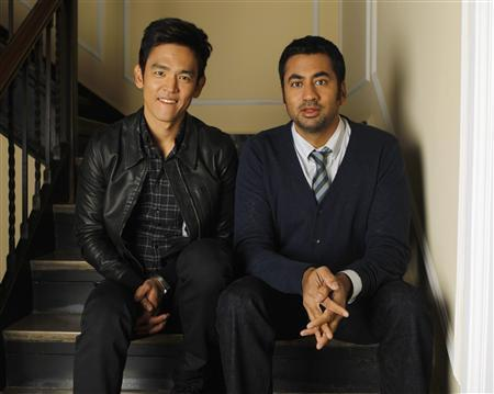 Kal Penn wallpaper containing a business suit, a suit, and a three piece suit entitled John Cho & Kal Penn ~ Reuters Press Junket Portrait