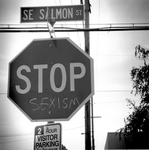 Feminism wallpaper probably containing a no parking zone called Stop sexism