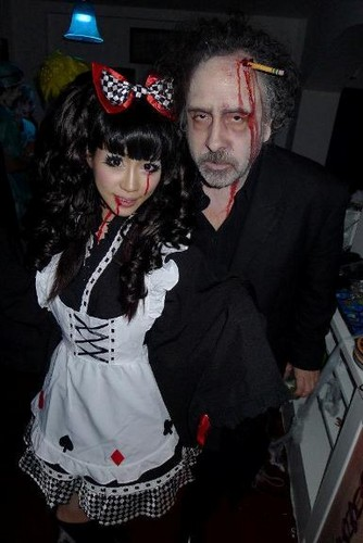 Tim burton kertas dinding probably with an outerwear, a box coat, and a well dressed person entitled Tim burton at his Halloween Party in his house in London (Arthur Rackham's House) on Oct 31, 2011.
