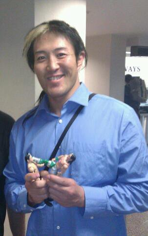 Yoshi Tatsu with a Wade Barrett Action Figure
