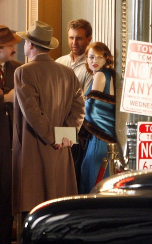 """Emma Stone and Sean Penn on the set of """"Gangster Squad"""" (November 2)."""