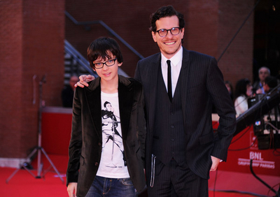 Asa Butterfield wallpaper containing a business suit, a suit, and a dress suit called Hugo Rome Premiere (October 31st 2011)