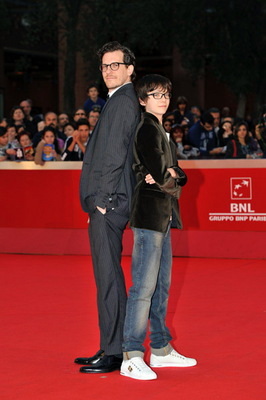 Asa Butterfield wallpaper with a business suit entitled Hugo Rome Premiere (October 31st 2011)