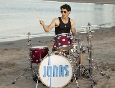 Nick Jonas playing drums