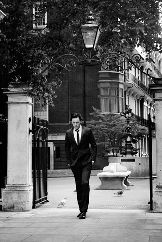 Tom Hiddleston wallpaper with a business suit, a street, and a well dressed person entitled Tom Hiddleston by David Titlow for Esquire UK December 2011