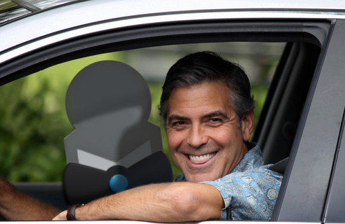 Clooney driving into the country