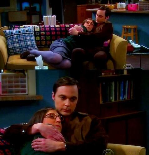 Sheldon and Amy hug.