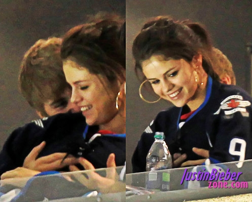 justin grabbing selena's boobs at hockey game