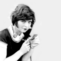 Clara Bow putting on makeup - silent-movies photo