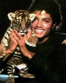 Michael Jackson with a baby tiger