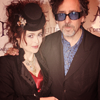 Helena Bonham Carter/Tim Burton photo probably with a business suit called tim & helena
