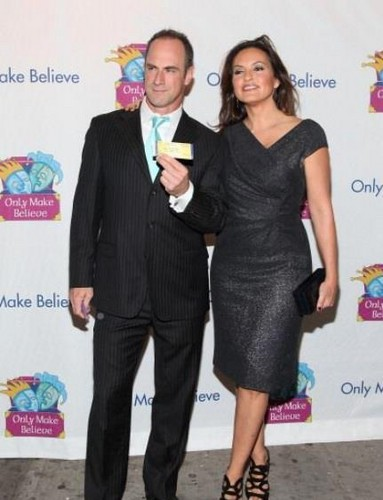 Elliot and Olivia wallpaper containing a business suit, a suit, and a well dressed person titled Chris & Mariska - Only Make Believe