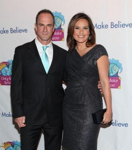 Elliot and Olivia wallpaper containing a business suit, a suit, and a well dressed person entitled Chris & Mariska - Only Make Believe