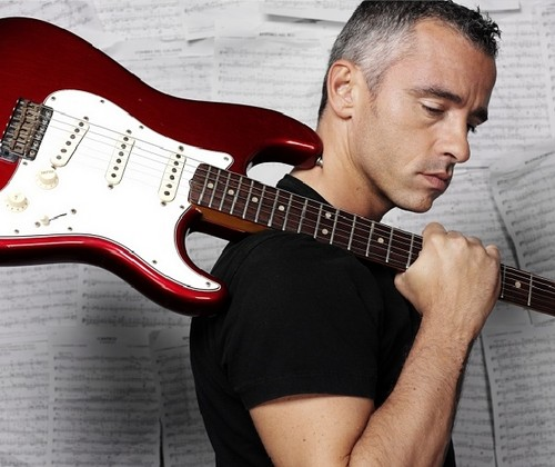Eros Ramazzotti wallpaper with an electric guitar called Eros Ramazzotti