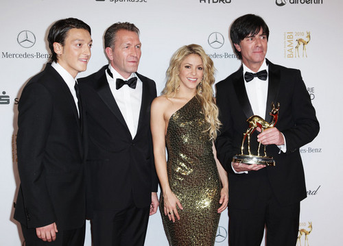 Mesut Oezil, Andreas Koepke, Shakira and Joachim Loew pose with the Special Bambi award at the Bambi