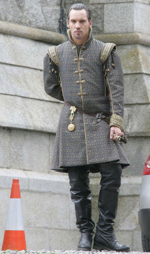 The Tudors wallpaper probably containing a hip boot, a surcoat, and a street entitled On The Set of Season 4