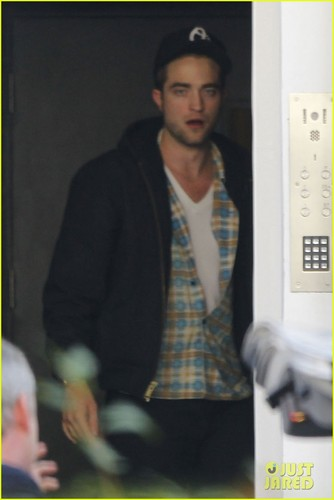Robert Pattinson lets out a yawn as he enters a private residence on (November 19) in London