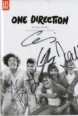 One Direction پیپر وال probably with a sign and a newspaper titled Scans of the 1D limited edition yearbook! [Up All Night] ♥