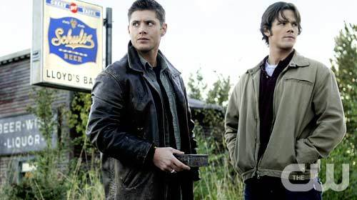 Television wallpaper possibly with a business suit, an outerwear, and a well dressed person called Sam and Dean Winchester (Supernatural)