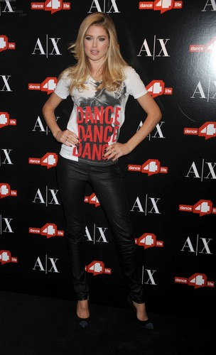 Doutzen Kroes wallpaper containing a sign and a hip boot titled Unveils The A|X Armani Exchange Dance4life T-Shirt In Honor Of World AIDS Day