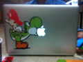 My Laptop With a Yoshi Sticker :D