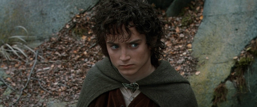 द लॉर्ड ऑफ द रिंग्स वॉलपेपर probably with a cloak, a hood, and an overgarment called Frodo (Elijah Wood)