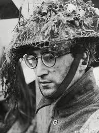 John Lennon wallpaper possibly with a green beret and a rifleman called Lennon is his How I Won The War uniform