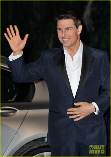 Tom Cruise wallpaper containing a business suit, a suit, and a well dressed person titled Tom Cruise: 'Mission: Impossible' Premiere in Dubai!