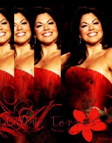 Callie Torres/Sara Ramirez in red dress