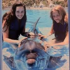Mary and Frannie Mouser with a dolphin!
