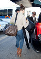 Khloe Kardashian at the Airport - khloe-kardashian photo